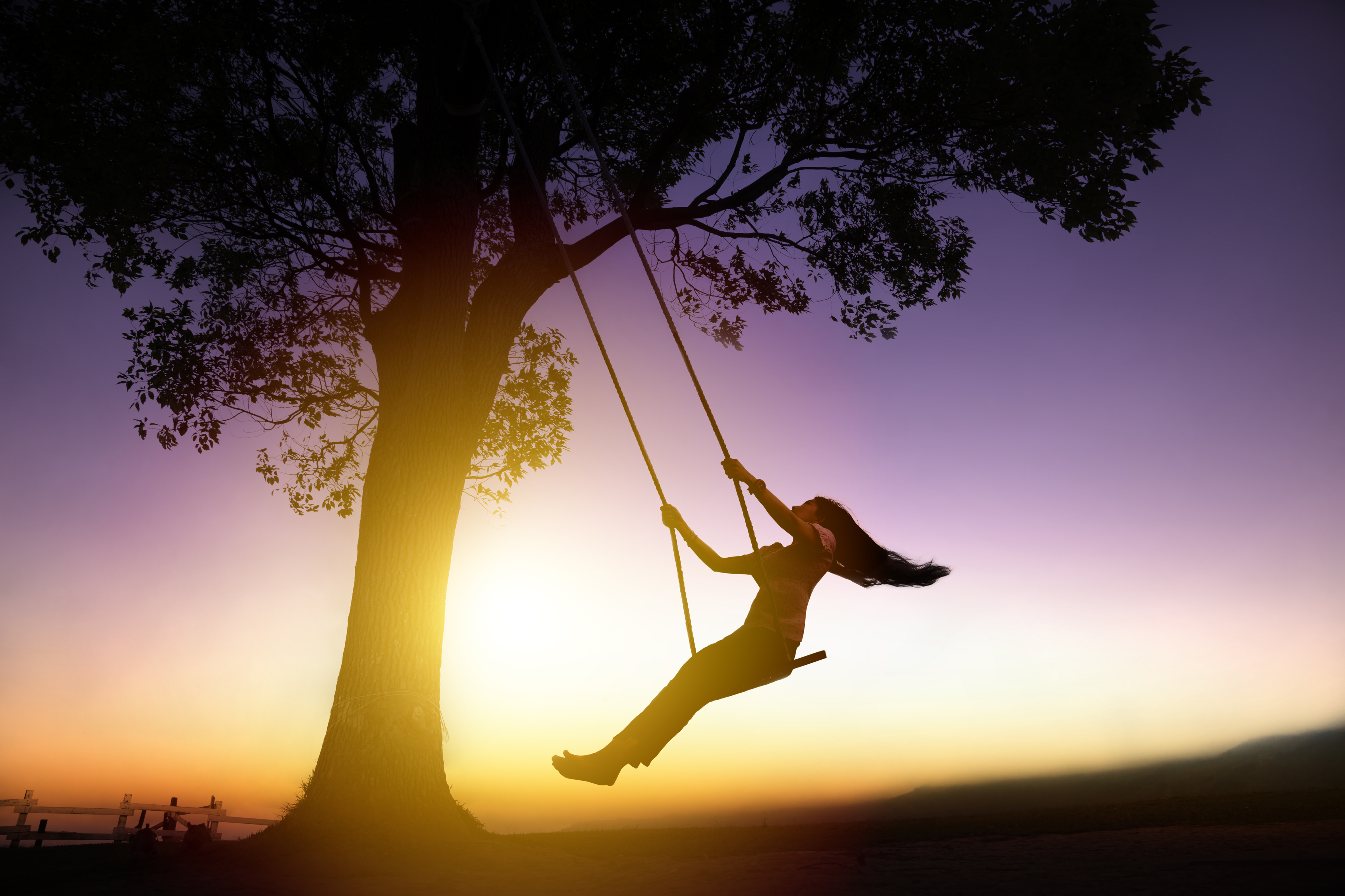 Girl on swing - enjoyment